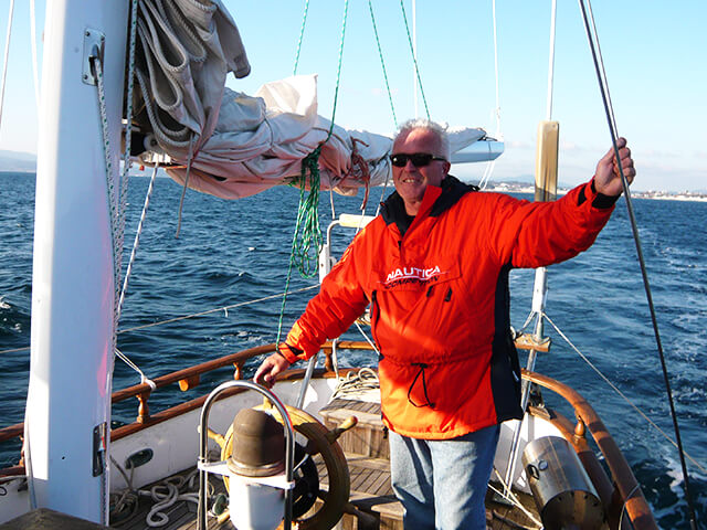 Mike Hollywood on a sailboat